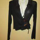 Блузка отличная,тонкая и приятная. Черного цвета.