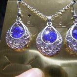 шикарний набор сережки ожерелье сереневого цвета