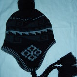 Новая фирменная шапка унисекс,размер единый,примерно от 54 до 58 см
