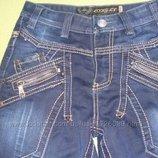 Красивые джинсы темно-синего цвета