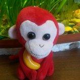 Миленькая обезьянка с вкусным бананчиком символ года