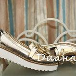 Туфли лоферы золотистые