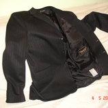продам новый мужской пиджак 54 размера.черного цвета