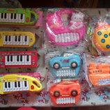 1.игрушечные музыкальные инструменты на батарейках