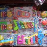 2.игрушечные музыкальные инструменты ксилафоны