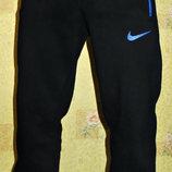 Теплые спортивные штаны Nike темно-синие , манжет.