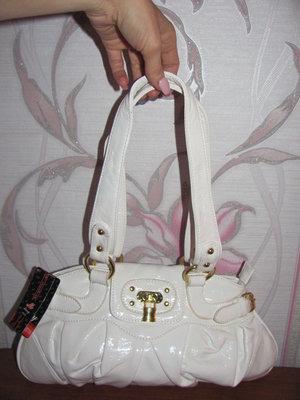 Новая белая лакированная сумка