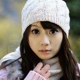 Милая мягкая вязанная шапочка на осень и теплую зиму. Белая