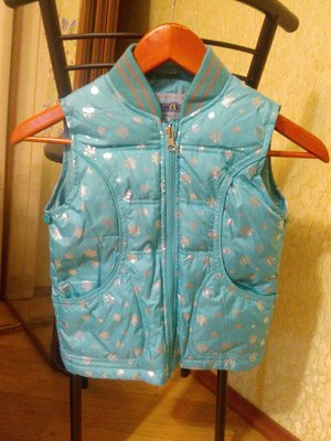 Donilo курточка-жилетка на пуху.