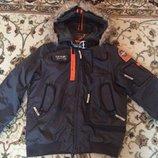 Бомбезна фірмова зимова куртка DMNK 152 р.