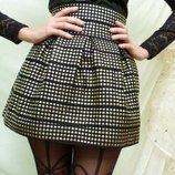 Стильная бандажная юбка з золотыми заклепками