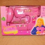 Детская швейная машинка Шьет