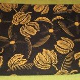 Продам ткань трикотин черный с желтыми листочками