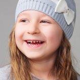 Нарядная детская шапка BOW Caskona в разных цветах