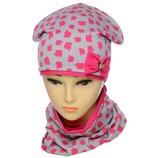 Яркий трикотажный комплект для девочки, состоящий из шапки и хомута снуда в разных цветах