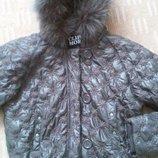 Коричневая теплая куртка с шикарным капюшоном