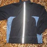 Куртка ветровка Тсм Германия размер M-L. В идеальном состоянии. Внизу куртки резинка фиксатор. За