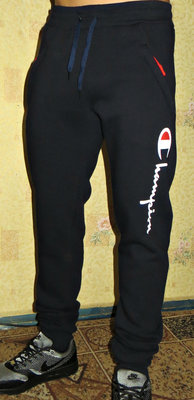 b9d6e0642fdf Теплые спортивные штаны Champion зауженные на манжете.