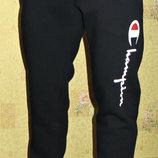 Теплые спортивные штаны Champion зауженные на манжете.