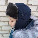 Тёплая зимняя шапка с мехом для мальчика