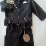 Пиджак нарядный с отстрочками.