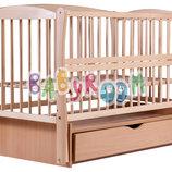 Детская кроватка Дубок Элит из бука на маятнике с ящиком и откидной боковиной