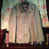 Универсальная куртка замеры грудь-60 см. длина-75 см.в хорошем состоянии.