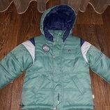 Зимний комбинезон для мальчика фирмы Godly Evolution.