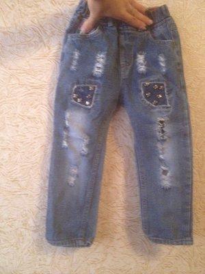 Стильные рваные джинсы состояние новое