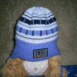 Зимнияя шапочка KRAFT на мальчика на голову 54-58 см. сост. идеальное.