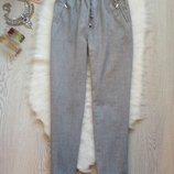 Серые плотные штаны брюки джоггеры на резинке и карманами на молнии с подворотами F&F