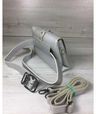 e5691a37185b Женская сумка на пояс- клатч Белла серебряного цвета с плетением и  кисточкой. Previous Next