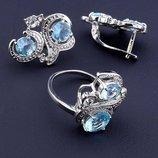 Комплект украшений серьги и кольцо с голубыми фианитами код 1553