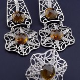 Комплект украшений серьги и кольцо с бежевыми фианитами код 1556