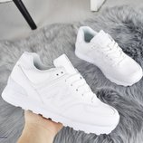 Женские белые кроссовки New Balance кожаные