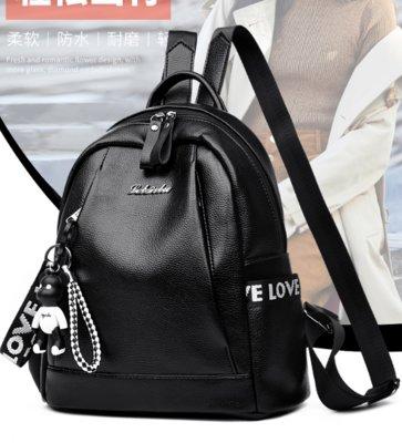 7628e26ec269 Женский черный тканевый городской рюкзак с брелком. Рюкзаки из кожзама.