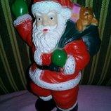 Игрушка Санта Клаус.
