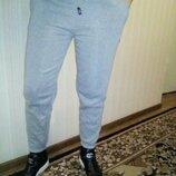 Спортивные брюки женские зауженные на манжете теплые