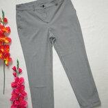 Суперовые стильные укороченные брюки в мелкую клетку с подворотом .
