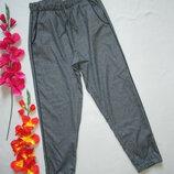 Крутые укороченные брюки джоггеры спортивного типа серый меланж со строчкой лампасами Orsay.