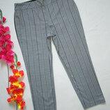 Шикарные укороченные брюки серый меланж в клетку с лампасами Dorothy Perkins.