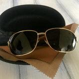 Супер популярные мужские очки polarized. Очки в золотистой оправе с черными линзами.