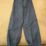 Продам новые,фирменные Tcm,штаны-дождевик, 8-10 лет.