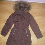 Пуховое фирменное пальто для девочки