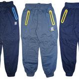 Спортивные брюки для мальчика с декором на карманах 134-164