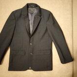Пиджак фирмы Next для мальчика 8 лет рост 128см темно-синего цвета