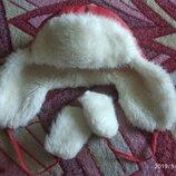 Зимняя, теплая шапка на меху с завязками.