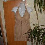 Платье блестит