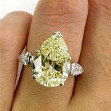 Серебряное кольцо с желтым муассанитом . Размер 16