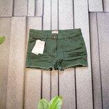 Короткие детские шорты зеленого цвета